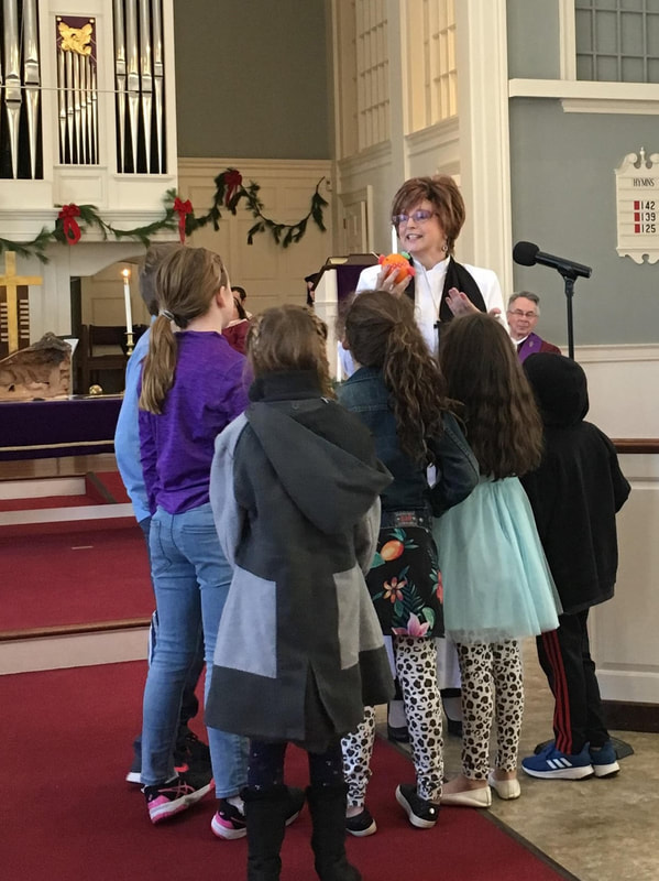 Dr. Elizabeth with children in the Sanctuary