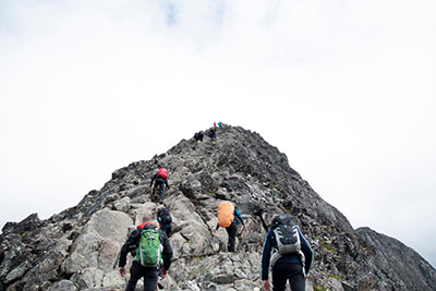 Hikers ascending a mountain